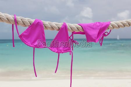 pink bikini drying on rope