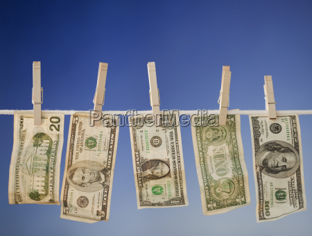 money drying on clothesline