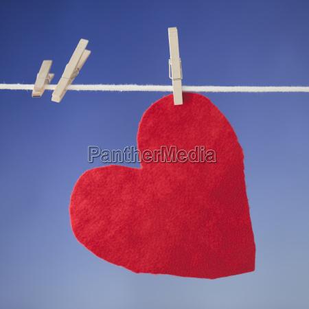 felt heart drying on clothesline
