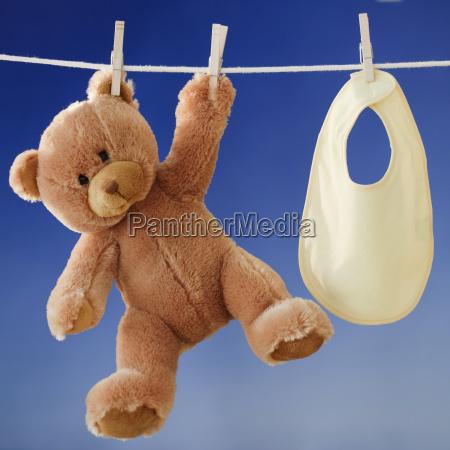 teddy bear and bib drying on