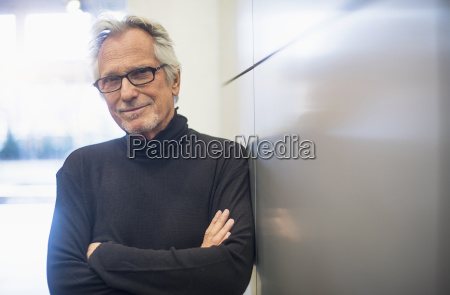 portrait of smiling senior man standing