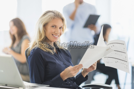 woman smiling at desk in office