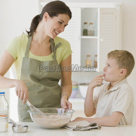 mother and son making batter