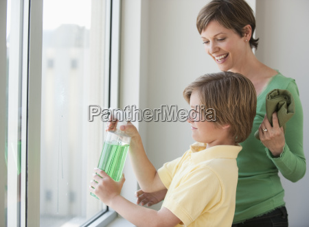 mother and son washing windows
