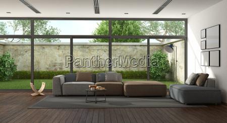 minimalistyczny pokoj dzienny z ogrodem na
