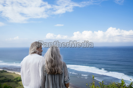 senior couple looking at the ocean