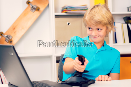 boy is playing computer game