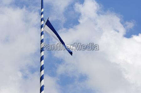 bavarian flag waving at maypole bavaria