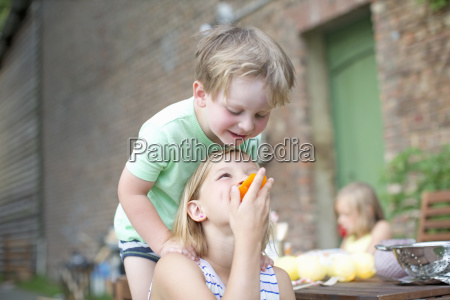 young boy and girl eating meal