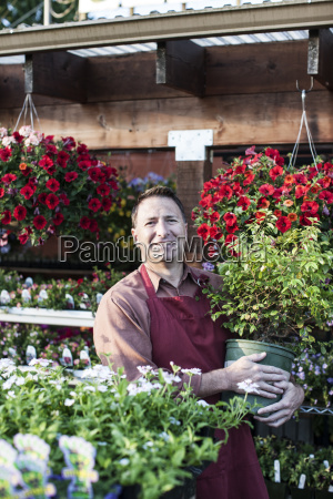 caucasian man a nursery owner standing