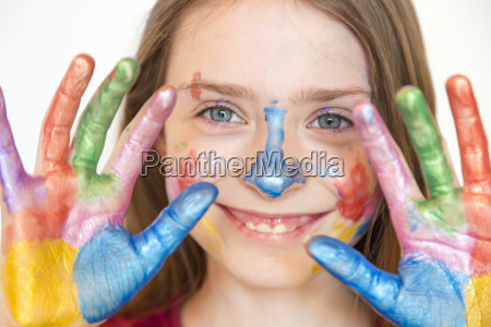 portrait of smiling girl with finger