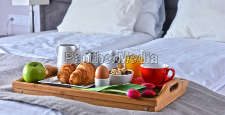 breakfast on tray in bed in