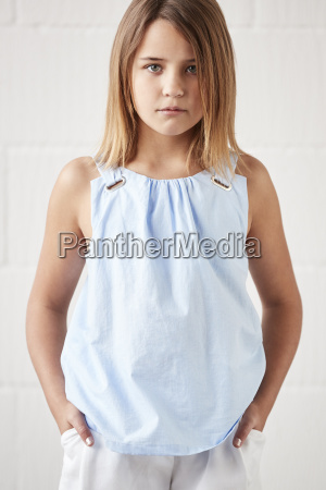 portrait of stylish young girl posing