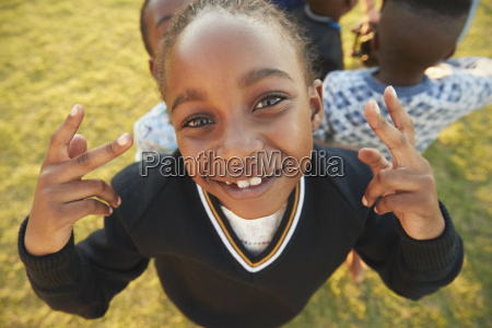 elementary school girl posing to camera