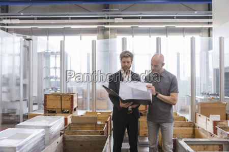 businessman and employee looking at plan