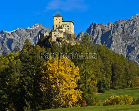 landscape in autumn with tarasp castle