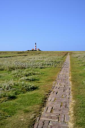 lighthouse westerhever in the salt marshes