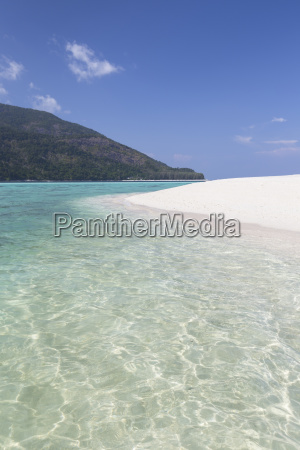 turquoise water and white beach at