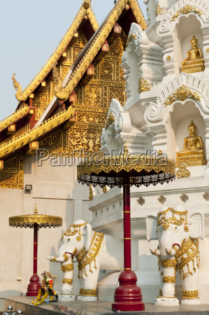elephants and buddha statues at chedi