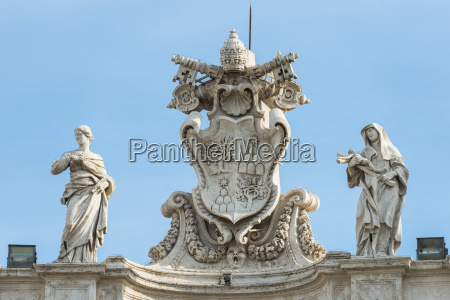 statues on the top of basilica