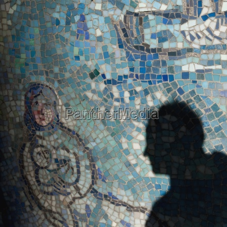 shadow of man on mosaic tiles