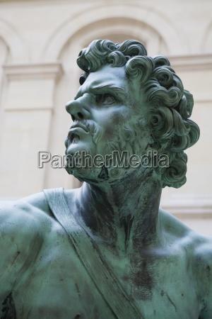 bust of bronze man statue paris