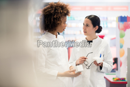 side view of two dedicated pharmacists