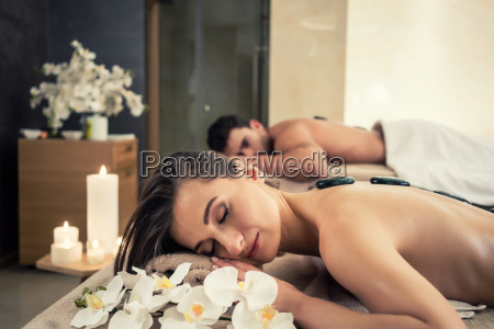 young couple relaxing under the stimulating
