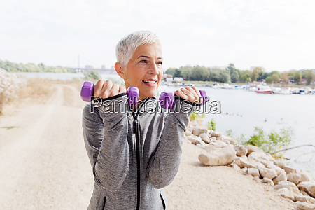 healthy mature woman exercise with weights