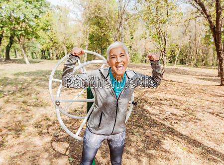 happy fit successful senior woman raised
