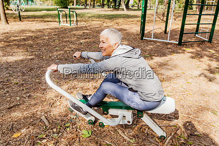 healthy mature woman practicing at outdoor
