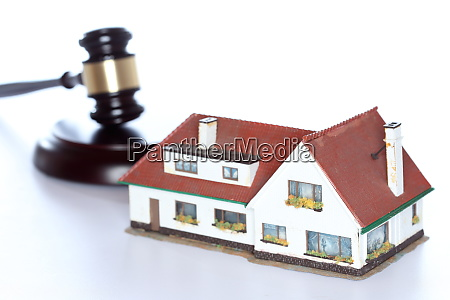 symbolic auction with house and gavel