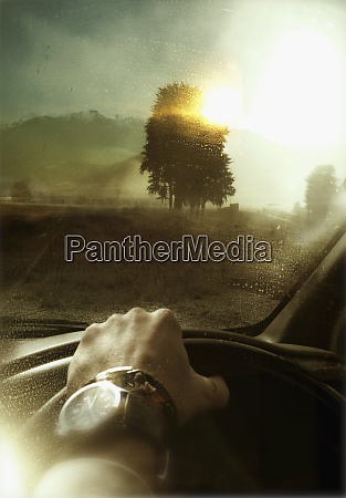 man driving car in countryside