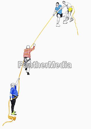 men helping friend climb cliff