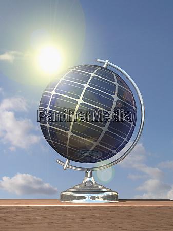 sun shining on globe covered in