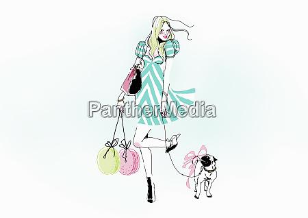 glamorous young woman carrying shopping bags