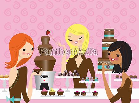 mlode kobiety cieszace sie jedzeniem czekolady