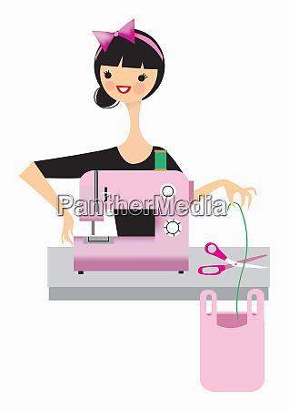 kobieta przy uzyciu maszyny do szycia