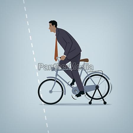 nieskuteczny biznesmen zmagajacy sie z rowerowym