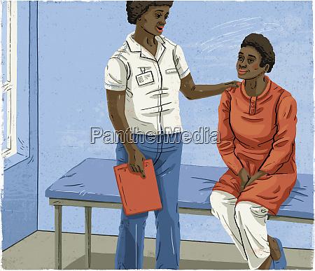 pracownik medyczny pocieszajacy pacjenta