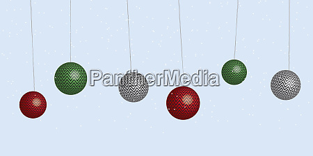 row of christmas baubles in the