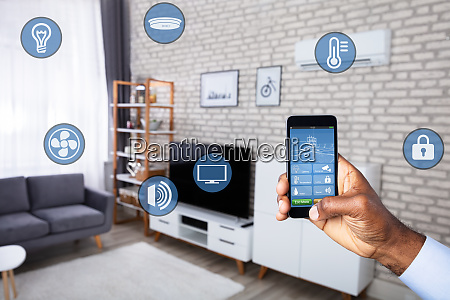 man using home control system on