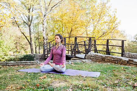 healthy young woman practicing yoga and
