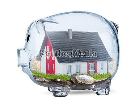przejrzysty piggy bank koncepcja nieruchomosci