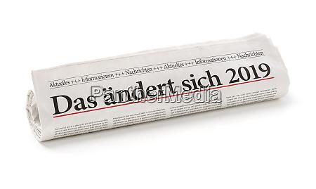 walcowane gazety z niemieckim naglowek das