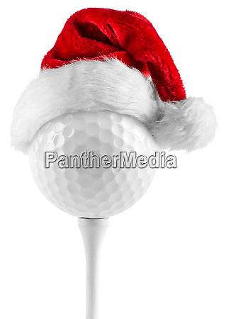pilka golfowa na tee santa hat