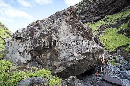 distant view of adventurous woman climbing