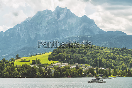 landscape with lucerne lake boat mountain