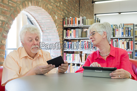 senior couple with tablet and e