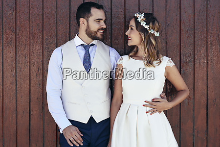 bridal couple standing in front of